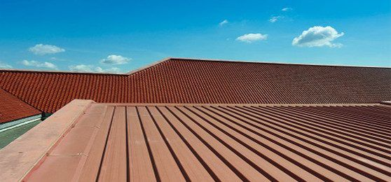 How Restoring a Commercial Metal Roof Can Save Money